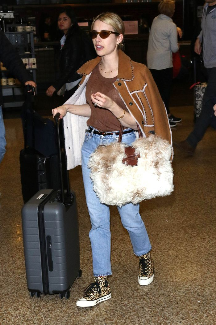 Emma Roberts wearing Converse sneakers to the airport