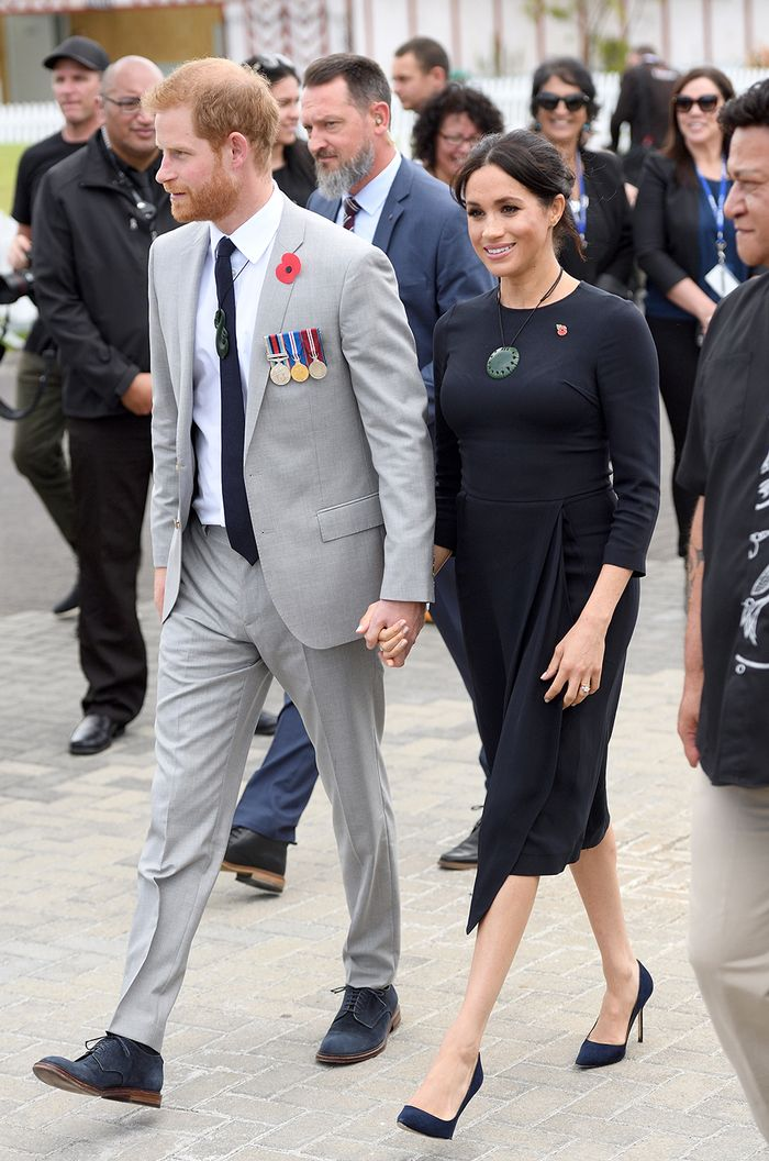 Celebrity fashion staples: Meghan Markle wearing a navy shift dress with court shoes