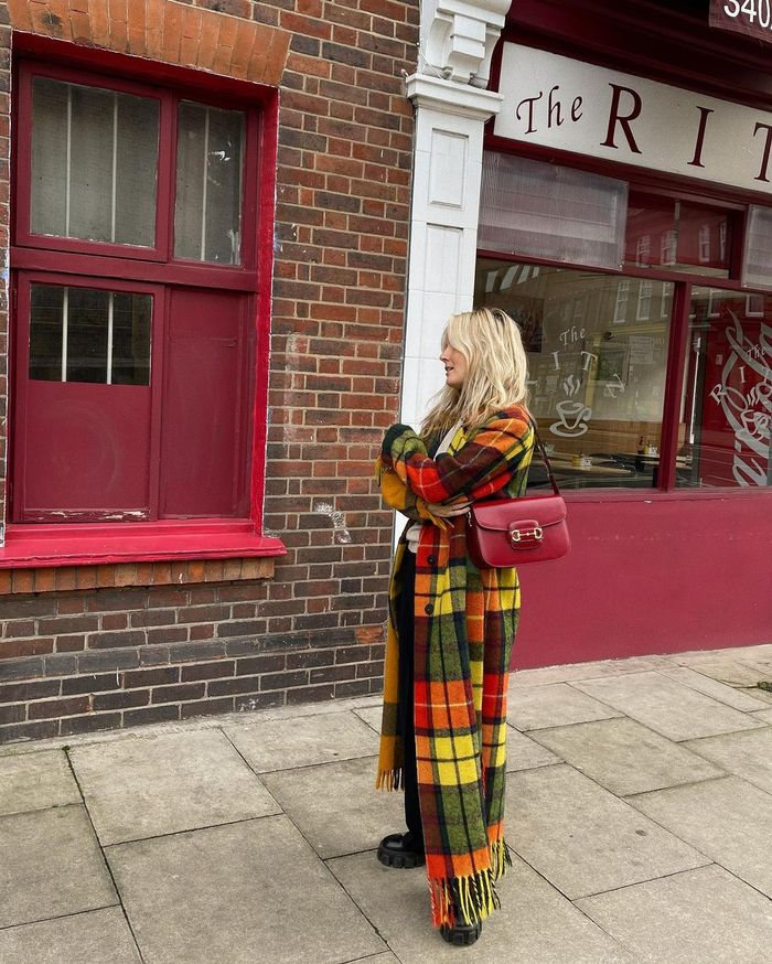 Best Spring Coats: Lucy wears a bright checked coat with fringed hem
