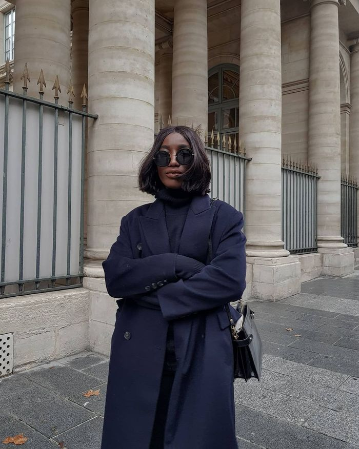 Best Spring Coats: Aïda wears an elegant navy coat