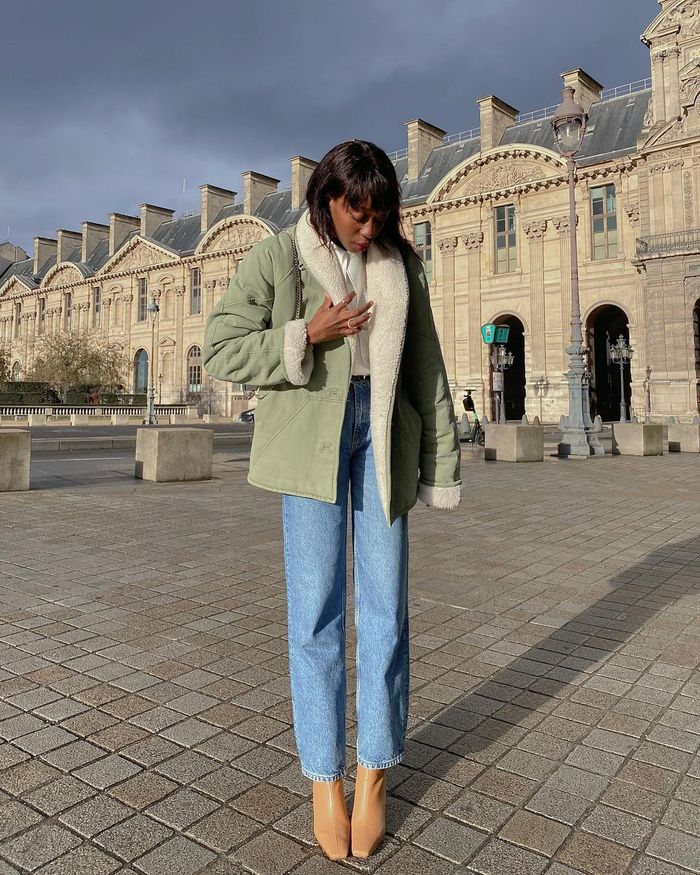 Best Spring Coats: Emmanuelle wears her shearling-lined coat with simple denim