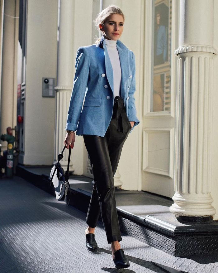 Blue blazer with white turtleneck and leather pants