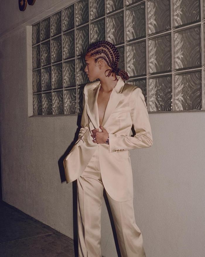 Best Celebrity Skin Products: Zendaya wearing braids and beige suit