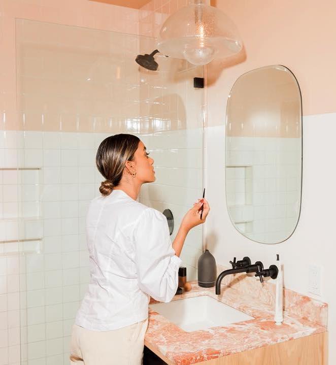 Makeup Expiry Dates: Stella Simona applying makeup at sink