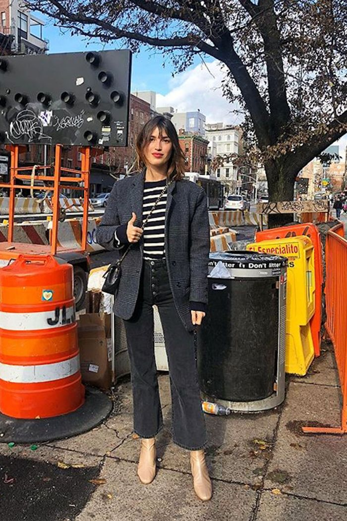 Best Striped Tops: Jeanne Damas wearing black Breton top
