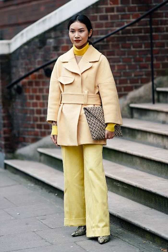 Pale yellow fashion trend: show goer in head to toe yellow outfit