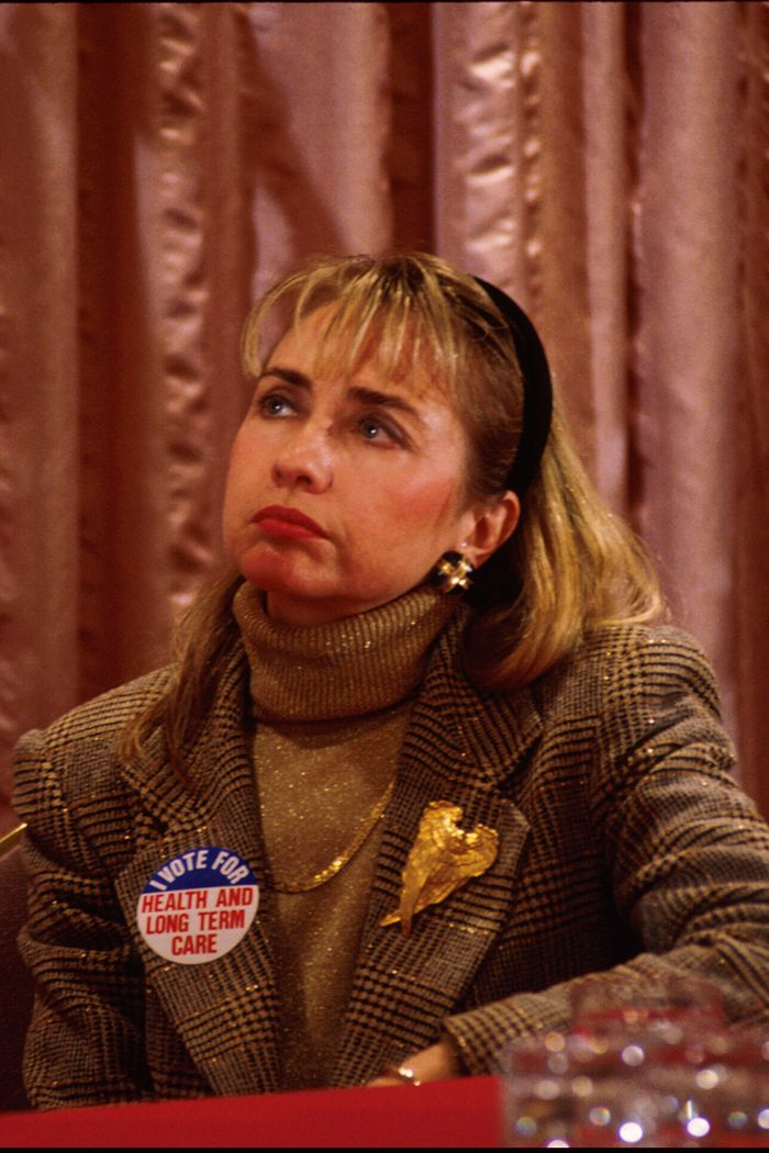 Hillary Clinton 90s style: check jacket and gold roll neck