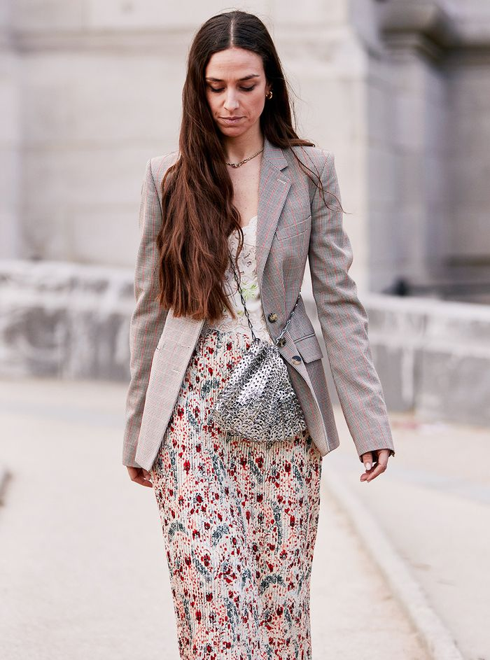 Erika Boldrin style: wearing a checked blazer, floral dress and Paco Rabanne metal bag