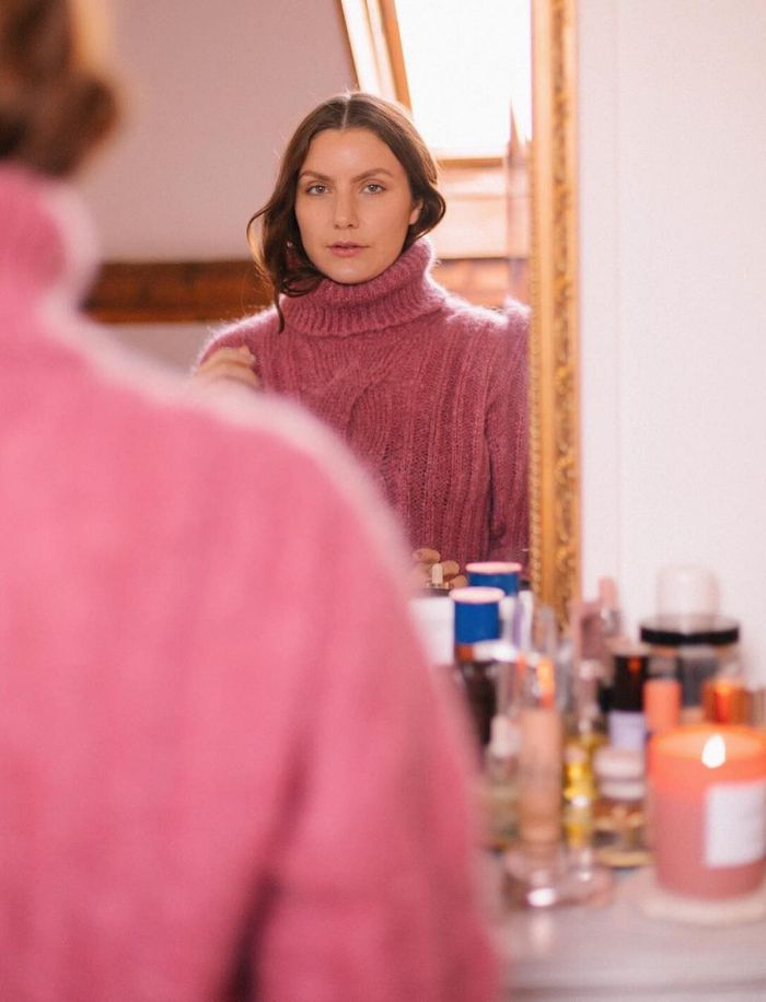 Drunk Elephant Skincare: Emma Hoareau wearing pink roll neck jumper