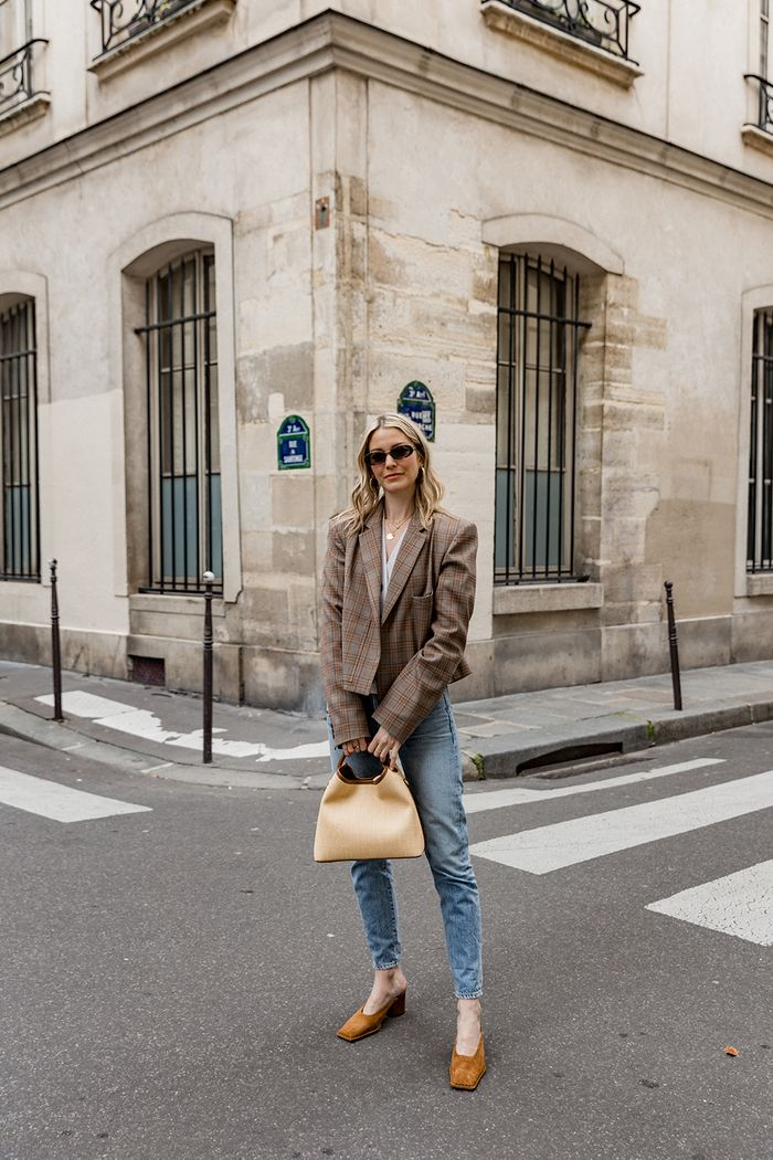 New French brands: Marissa Cox of Rue Rodier wearing a checked blazer, Jacquemus mules and Elleme bag witih jeans