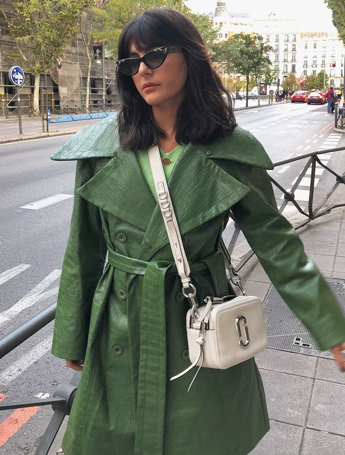 Best Small Designer Crossbody Bags: Maria Bernad wears a Marc Jacobs Snapshot crossbody bag.