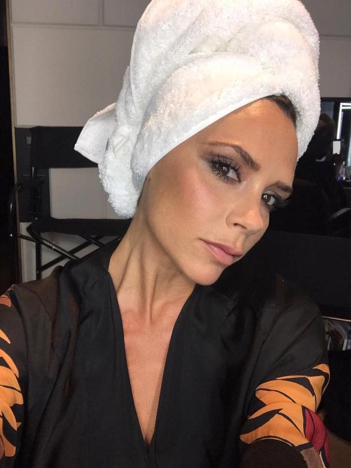 Victoria Beckham Facial Steamer: VB wearing head towel and smokey eye