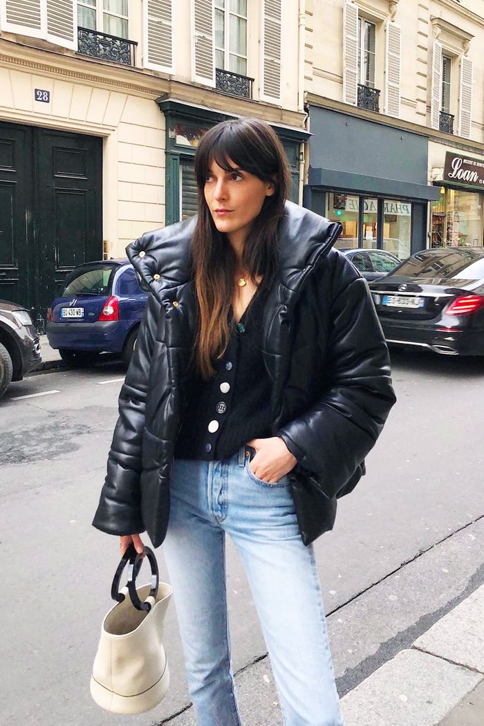 French girl cardigan and jeans: Leia wearing bleach jeans and black knit