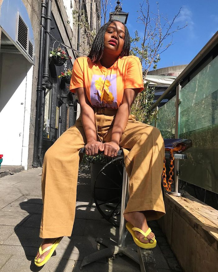 Best SPF Products for Summer: Aga Oguntodu wearing animal print trousers and sunnies