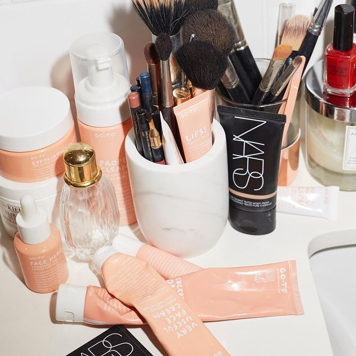Go-To Skincare Australian Beauty: Peach products in marble bathroom