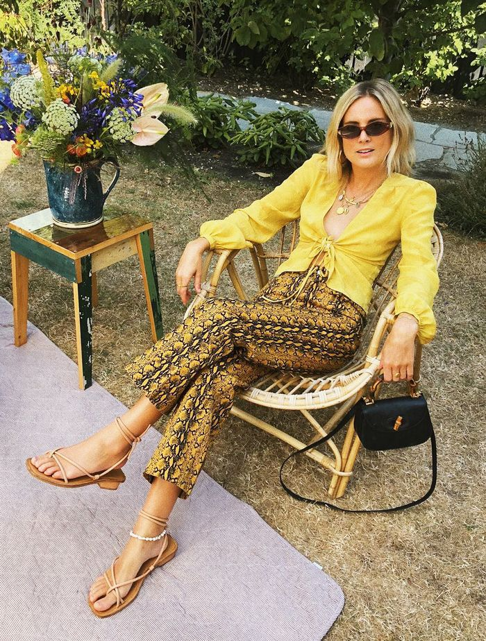 What to Wear to a Wedding Abroad: Lucy Williams in a yellow top and printed trousers