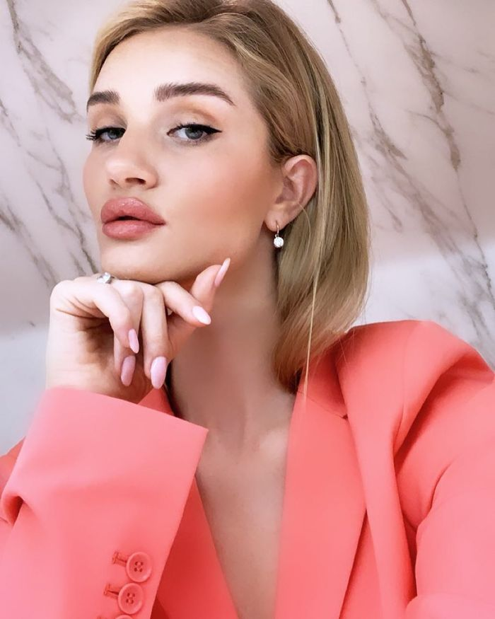 How to grow hair faster: Rosie Huntington-Whiteley wearing coral blazer