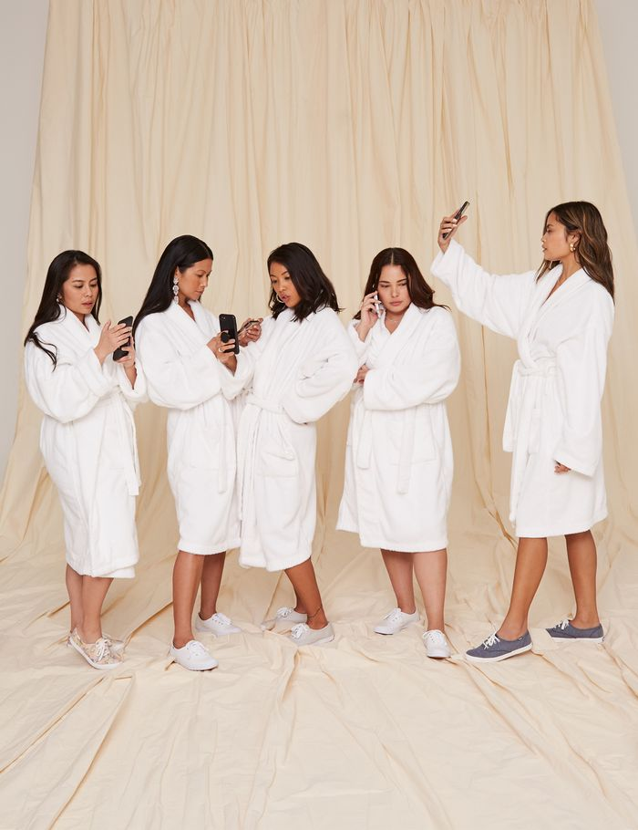 Raissa Gerona and the Revolve team in their Keds sneakers and robes