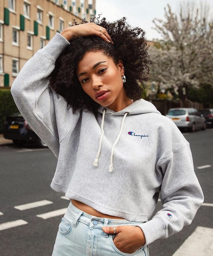 Shampoo for curly hair: ASOS Lesley wearing sweatshirt and silver hoops