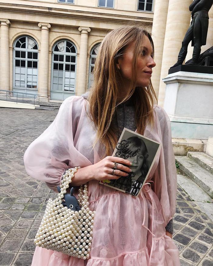Best Dry Shampoos: Pernille Rosenkilde wearing pink dress and beaded handbag