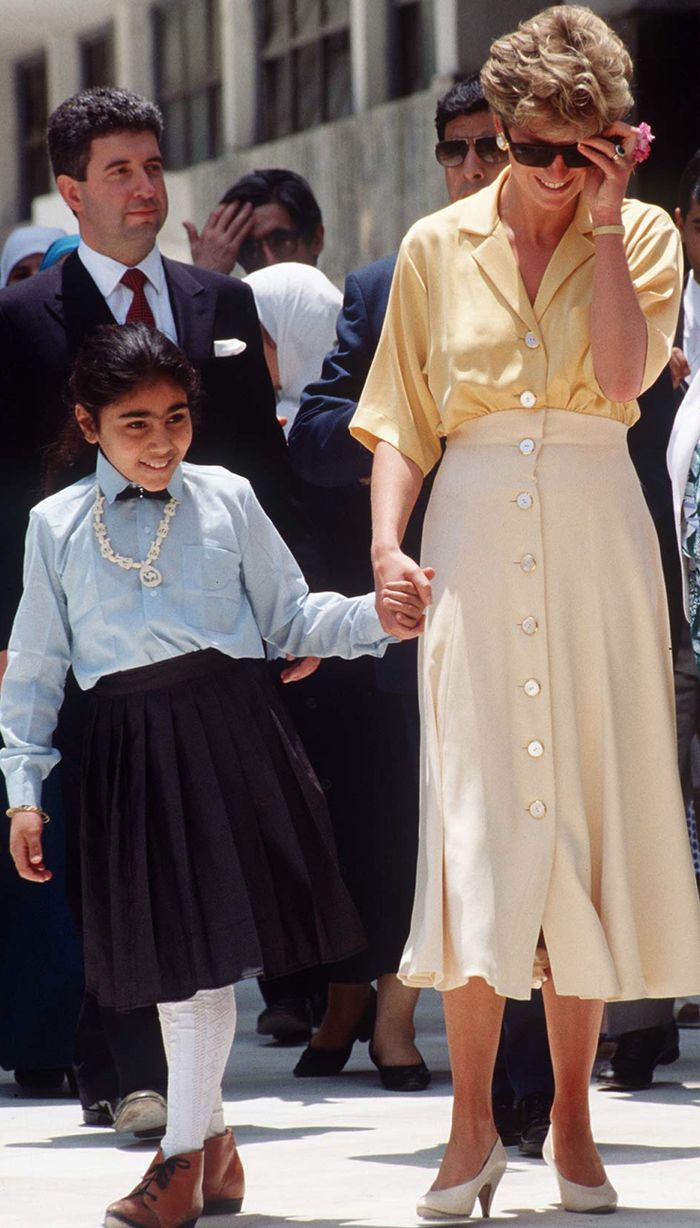 Princess Diana holiday outfits: in a yellow button through blouse and cream skirt in Egypt