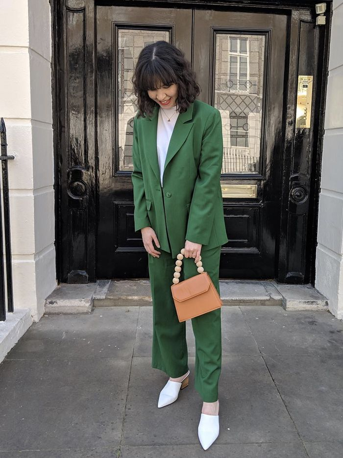 Best Acne Products: Mica Ricketts in a green suit