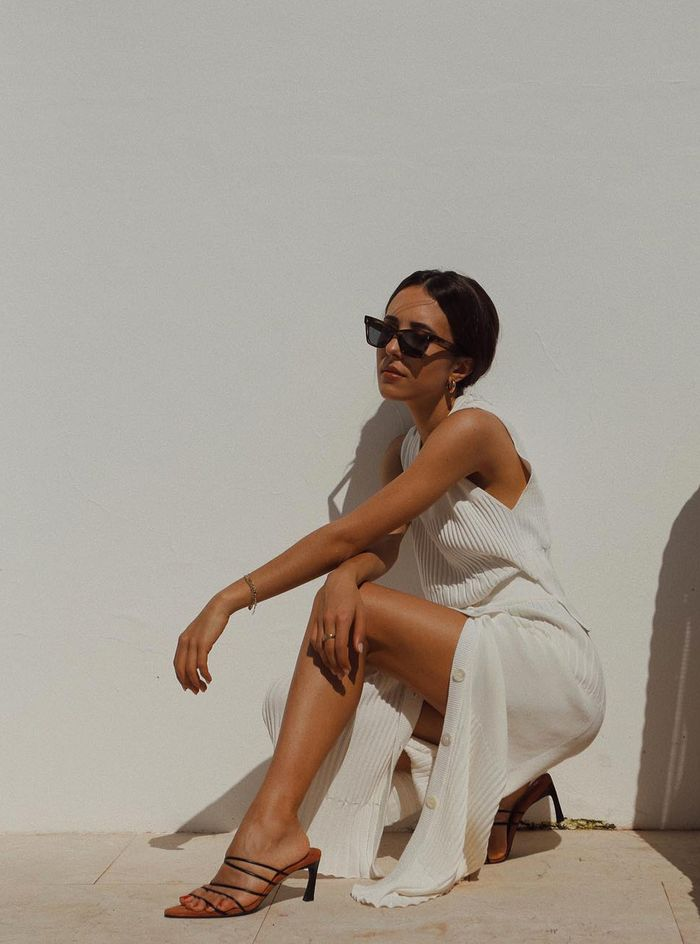 Spring to summer fashion transition: Debora wearing a beige ribbed dress with strappy sandals