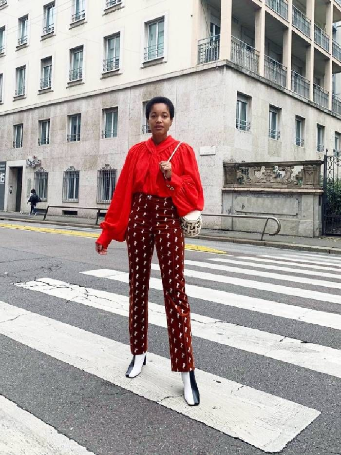 Tamu Mcpherson wears Wandler square toe boots with chloe velvet trousers.