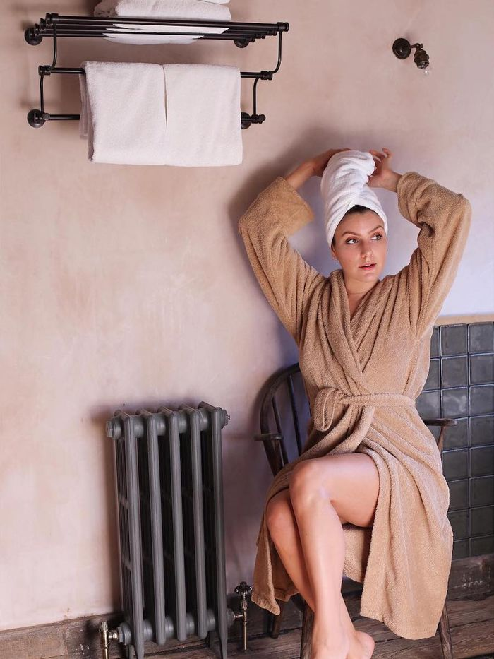Essential Oils Guide: Emma Hoareau wearing bathrobe and head towel