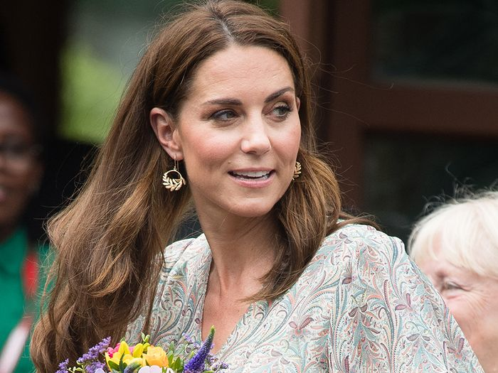 Kate Middleton wearing a paisley dress with espadrilles