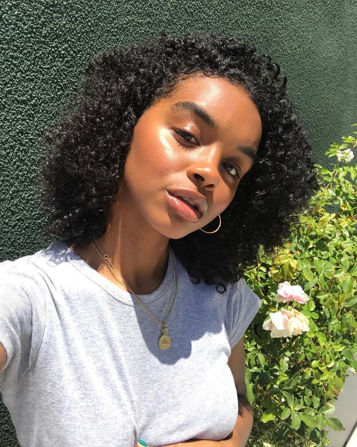 Budget Skincare Dupes: Simone with glowing skin and grey t-shirt