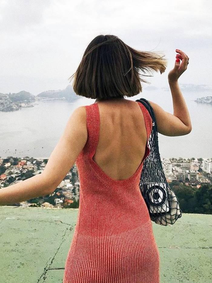 best bras for backless dresses: elif wears a backless dress