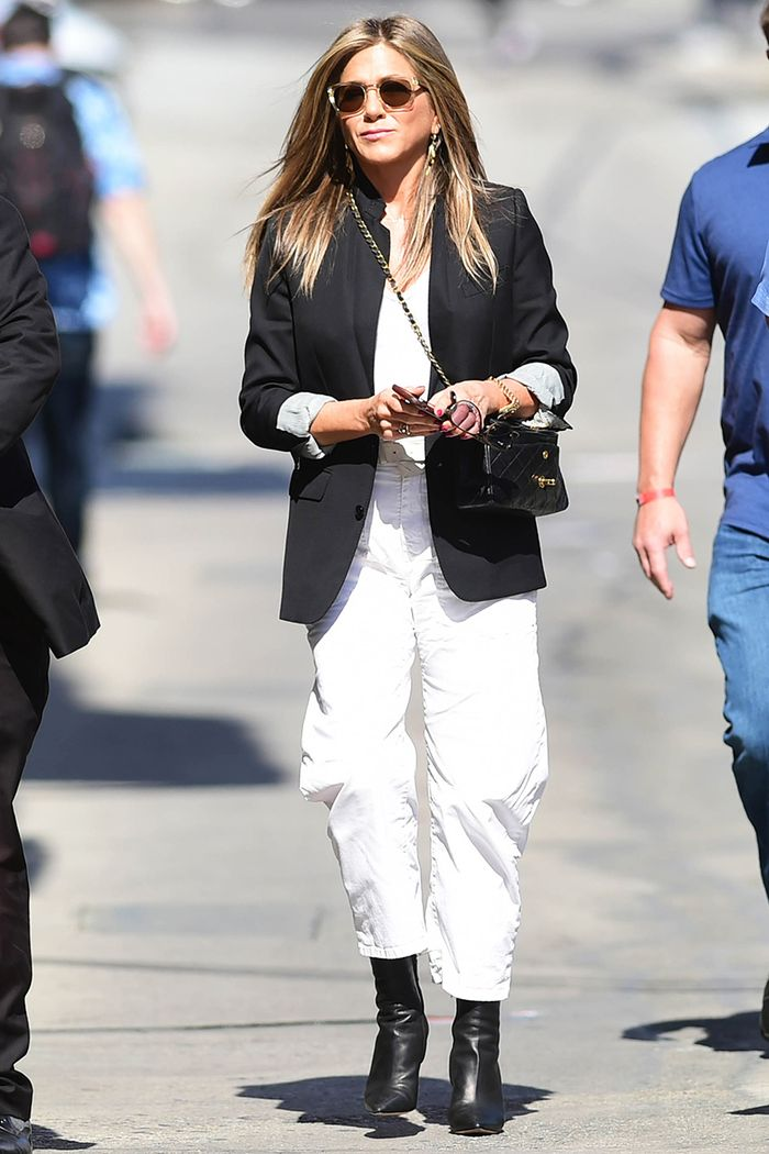 Jennifer Aniston wearing ankle boots during summer