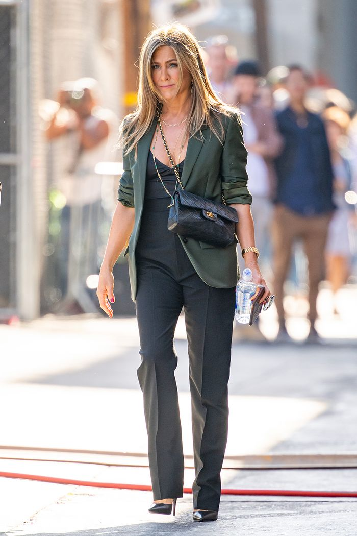 Jennifer Aniston summer style: blazer and black trousers