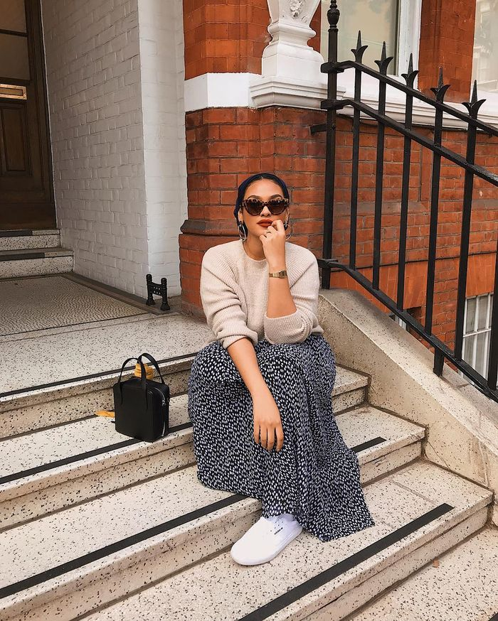 Manal Chinutay Makeup: Chinutay wearing sunglasses, neutral jumper and maxi skirt