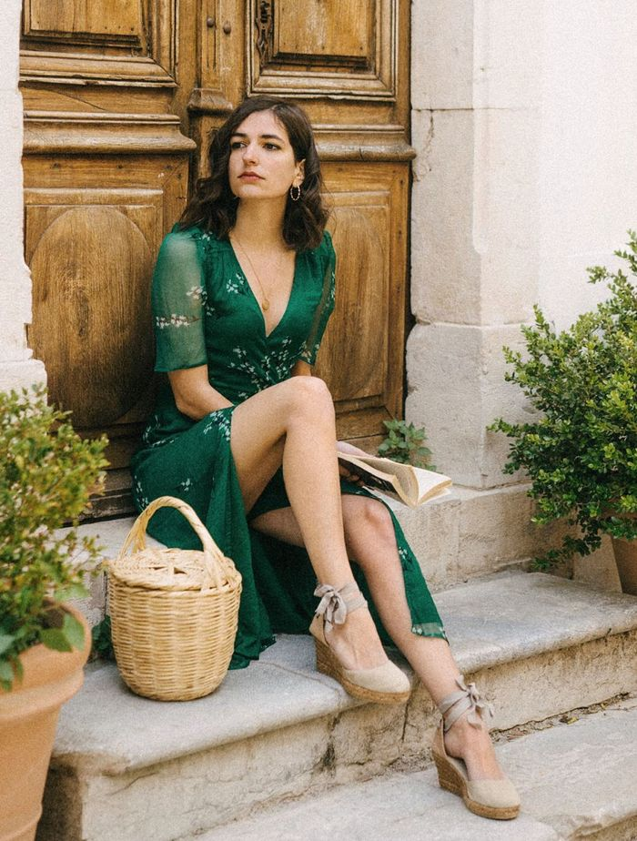 French Girl Wedding Guest Outfits: Aria Di Bari in a green floral dress and basket bag