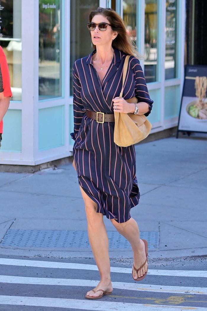 Cindy Crawford wearing flip-flops in NYC