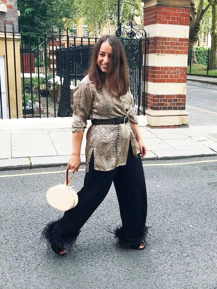 best leopard print blouse: hannah almassi's take on the look, with a belt and black trousers