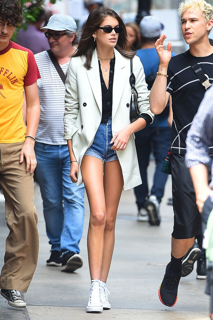 Kaia Gerber denim shorts and sneakers outfit