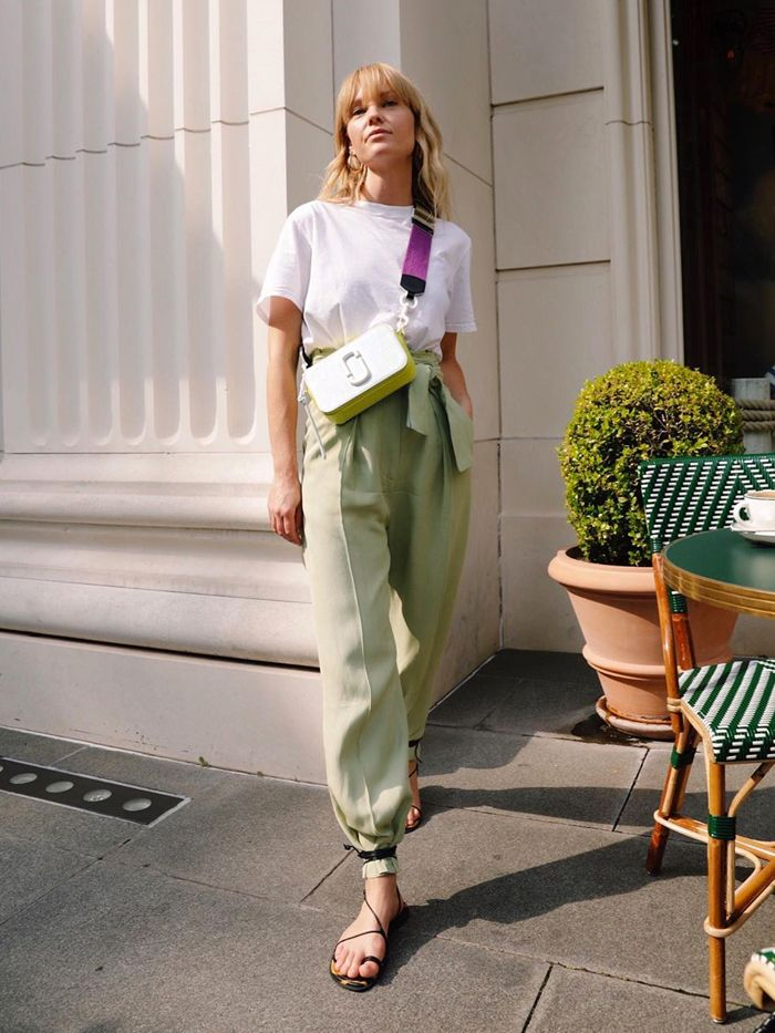 best h and m sandals: jeanette madsem wearing a white t-shirt and loose trousers with h&m sandals