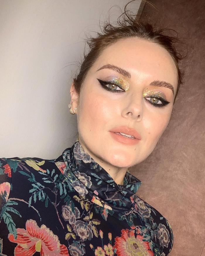 Katie Jane Hughes Makeup Bag Cost: Katie wearing floral top and glitter eyeshadow