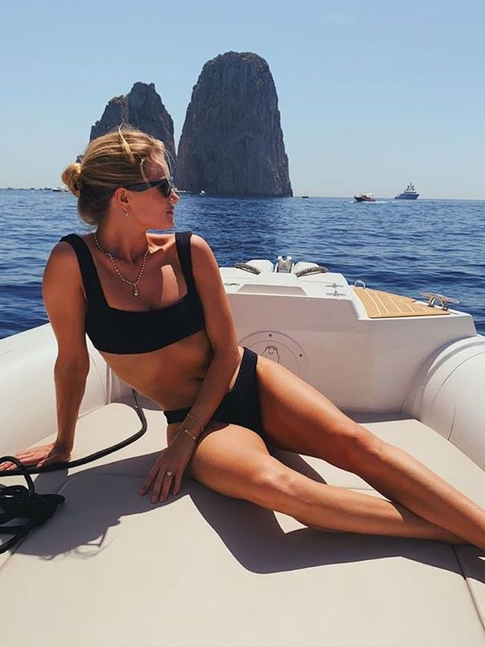 How to do a bun: Rosie Huntington-Whiteley wearing a bun on holiday
