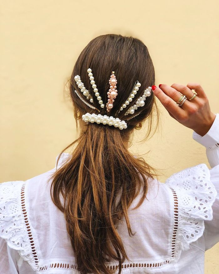 Summer Hairstyles: Nina Sandbech wearing low ponytail and pearl hair clips