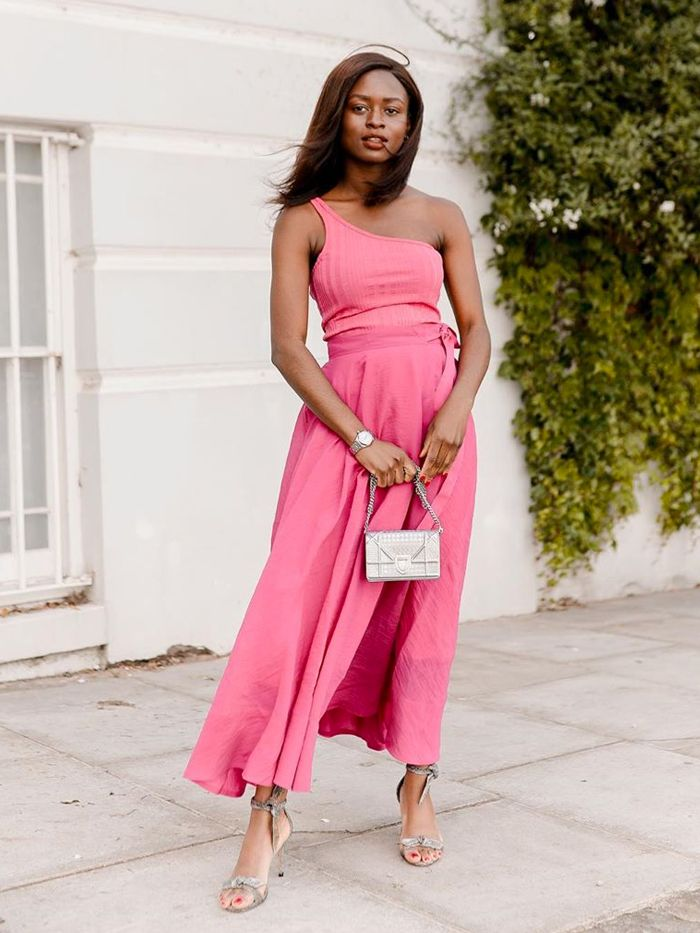 cheap wedding guest dresses: enis wardrobe in a pink one-shoulder dress