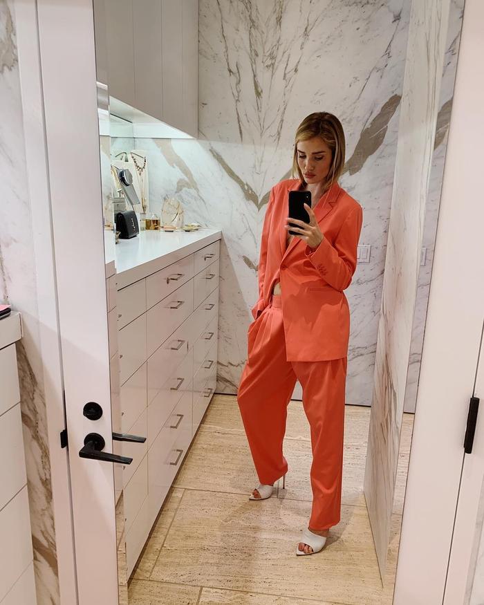 Shani Darden Texture Reform Serum: Rosie Huntington-Whiteley wearing orange suit