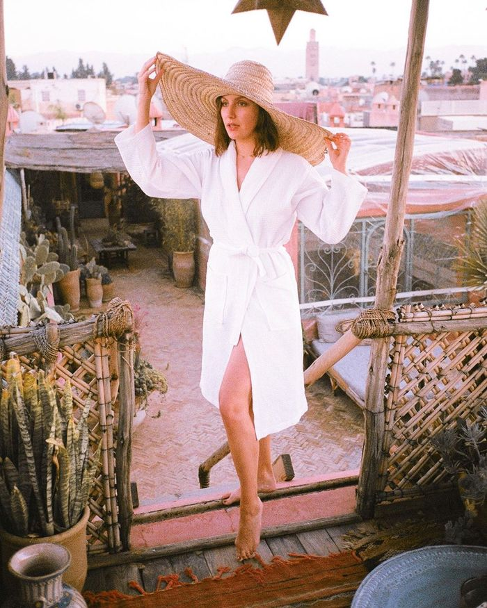 Hot Weather Beauty Products: Emma Hoareau wearing oversized sun hat
