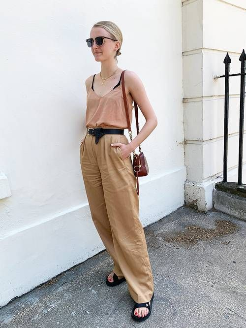 Minimal holiday capsule wardrobe: Joy Montgomery in beige trousers and cami