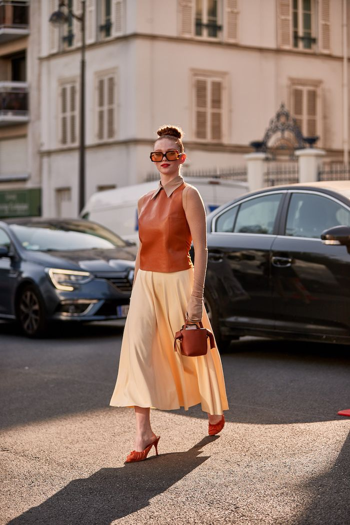 Easy Hairstyles Paris Fashion Week: Woman wearing braided top knot