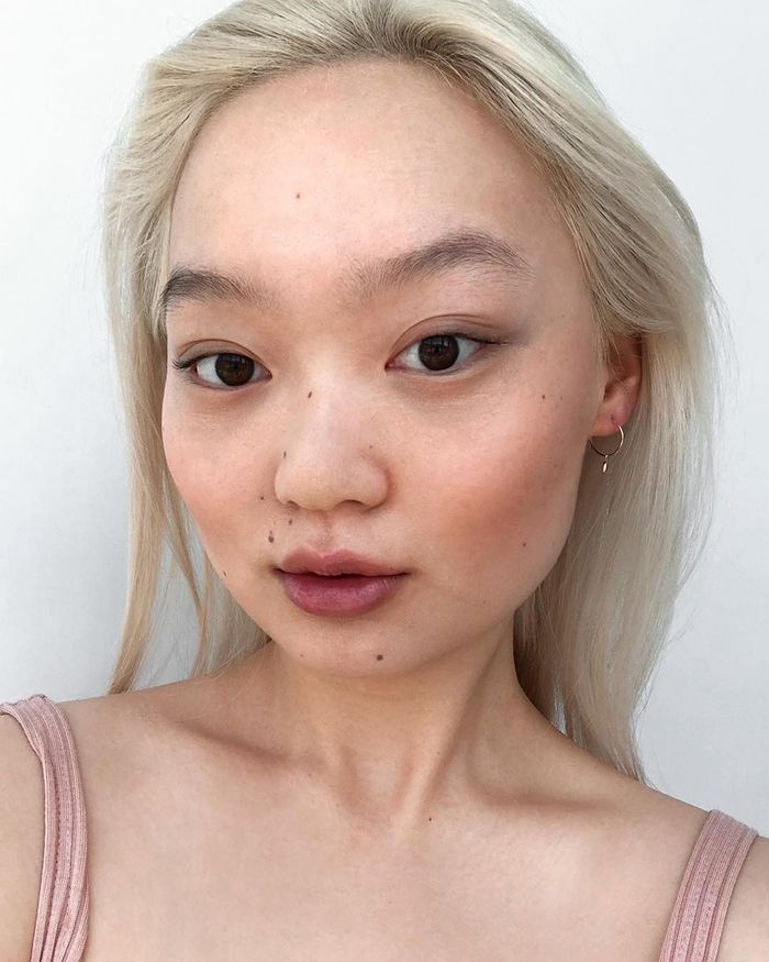 Glossier Generation G Lipsticks: Jessica Wi wearing shade Jam