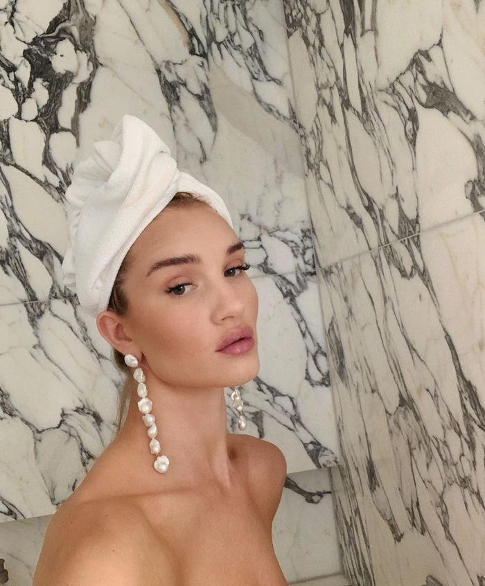 How Often Should You Wash Your Hair: Rosie Huntington-Whitely wearing head towel